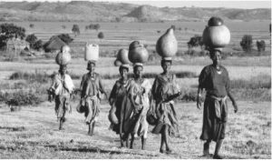 A group of women return from Lake Tana with jugs of water