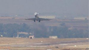 An aircraft said to be carrying Mr Bashir takes off from an air base near Pretoria on Monday